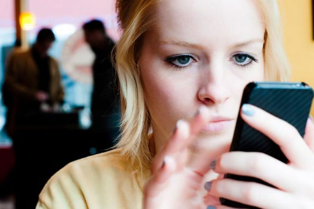 young-woman-using-a-mobile-phone-pic-getty-images-580339023